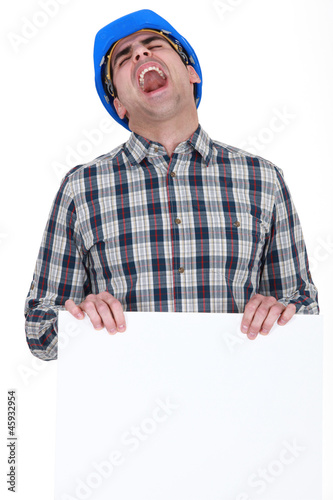 Screaming builder with a board left blank for your message