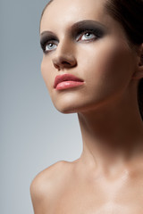 woman face closeup portrait with smoky eyes