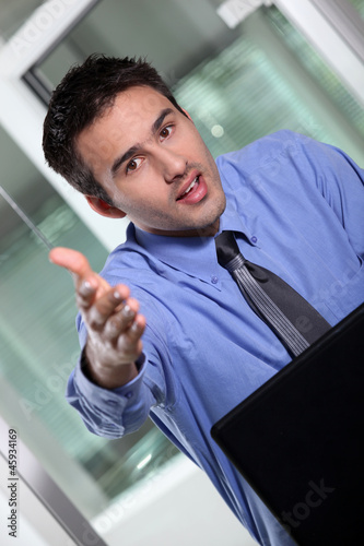 Businessman holding his hand out for a handshake
