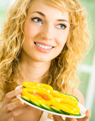 Happy smiling young woman with salad