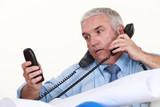 senior architect getting multiple calls