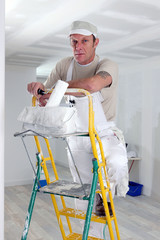 Painter climbing ladder
