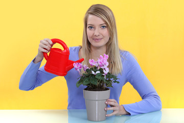 Woman watering a potted plant