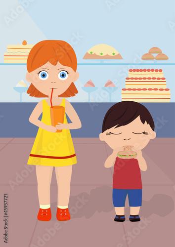 boy and girl eat near showcase