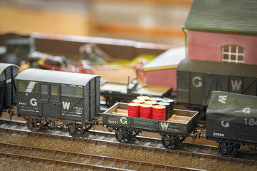 model railway freight train transporting oil drums
