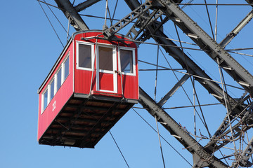 Ferris wheel with red cabine, Prater park in Vienna