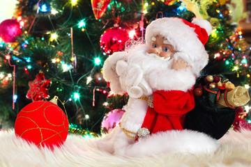miniature toy Santa Claus, near green fir-tree