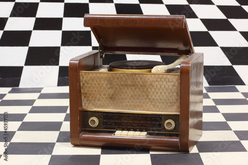 gram player with radio in black, white square room