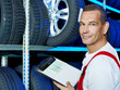 Mechanic looking for the right tires with car registration book