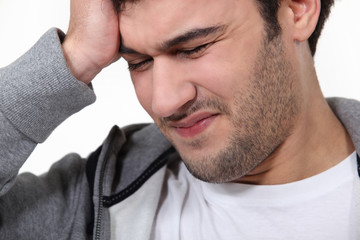 Man suffering from a throbbing headache