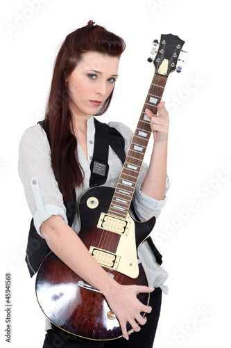Brunette posing with electric guitar
