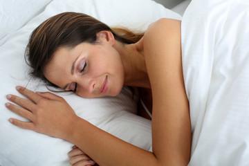 Woman feeling good asleep in bed