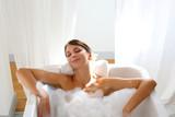 Fototapety Beautiful woman relaxing in bathtub