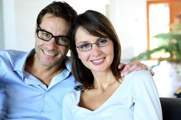 Smiling couple wearing eyeglasses