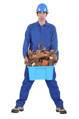 Man with a container full of construction waste materials