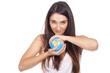 beautiful young woman holding a globe in hands