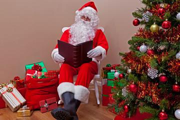 Santa Claus reading the list