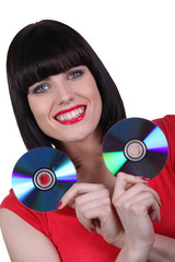 woman holding two CD