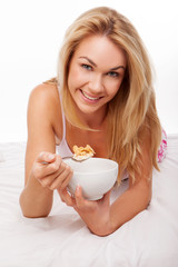 Beautiful woman enjoying a healthy breakfast