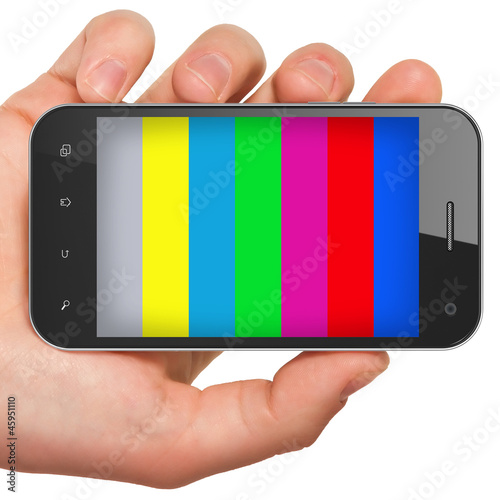 Hand holding mobile smart phone with tv test pattern screen.