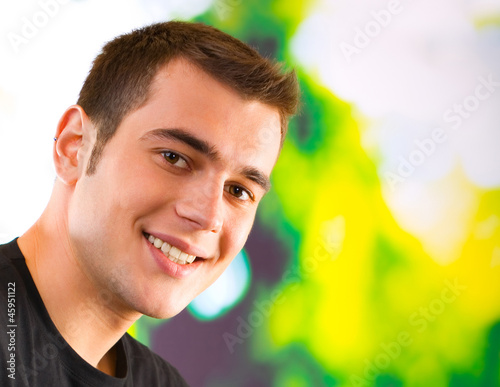 Happy smiling young man, outdoor