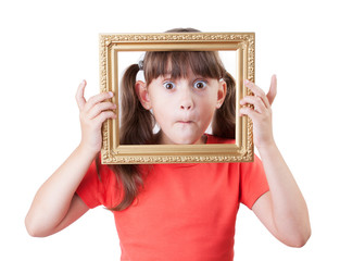 Little girl holding a frame for pictures