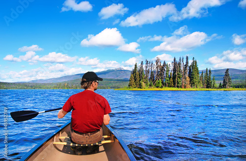 Canoeing on a lake in the wilderness of British Columbia, Canada