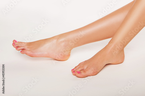 Female feet with varnished toenails