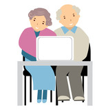 elderly people at a computer