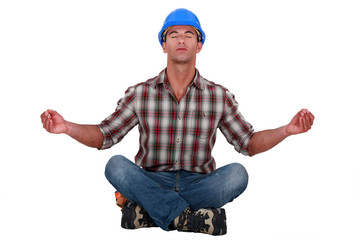 Laborer sitting in a yoga posture