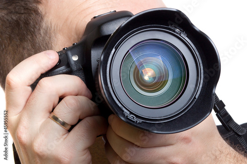Photographer taking pictures with digital camera over white