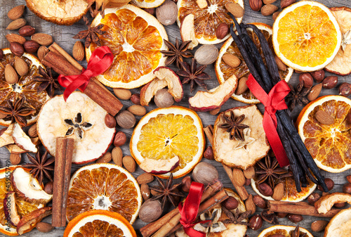 Christmas spices with dry orange and apple slices - 45955749