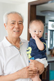 Asian grandfather holding grandson