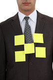 Businessman's blazer covered with sticky notes