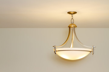 Modern ceiling lamp in a new home
