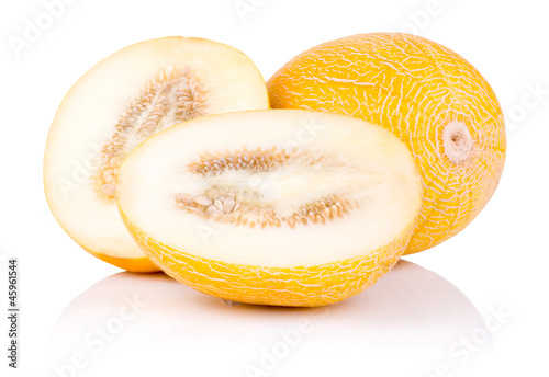 Whole fresh honeydew melon and two half isolated on a white back