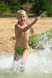Little girl running through the water