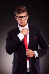 business man fixing his tie