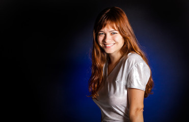 A young woman is smiling