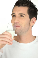 Man drinking glass of milk