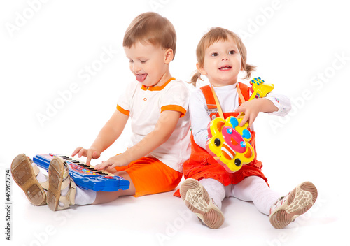 Children with toys in the studio