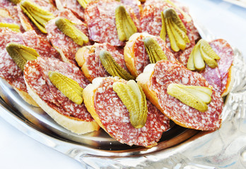 Little sandwiches with smoked sausage and salted cuke
