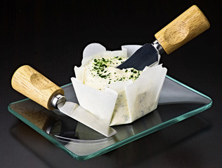Spread cream cheese on glass tray