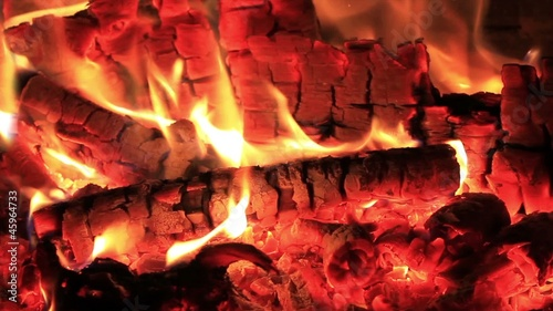 Hot fireplace full of embers and fire with the sound