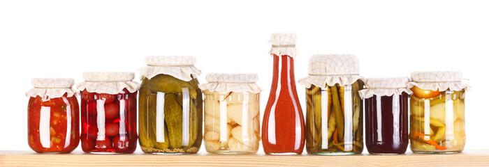 Various preserves on a wooden shelf