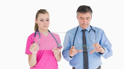 Doctors holding glass slides