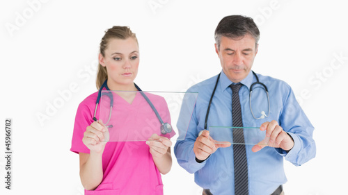 Doctors holding glass slides