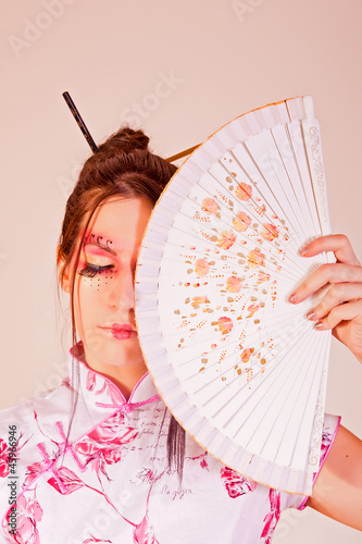 Traditional woman with a fan
