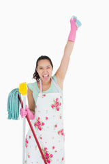 Shouting woman holding a sponge in the air