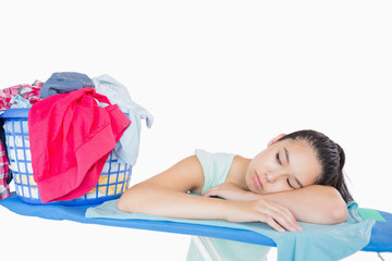 Woman sleeping on an ironing board